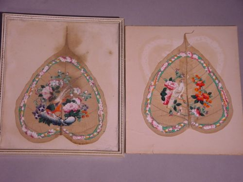 pair of painted buddha leaves