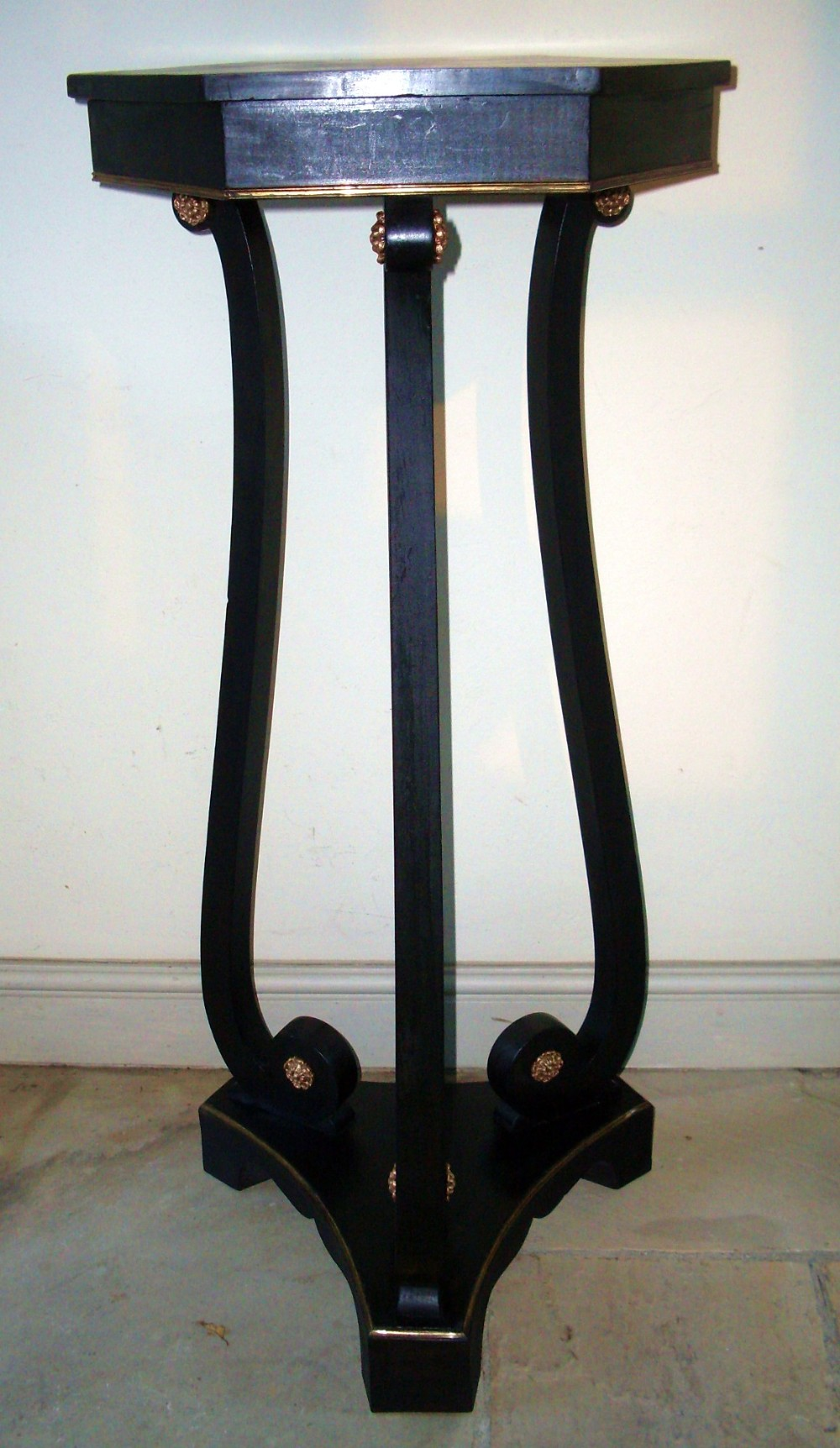 an ebonised torchre