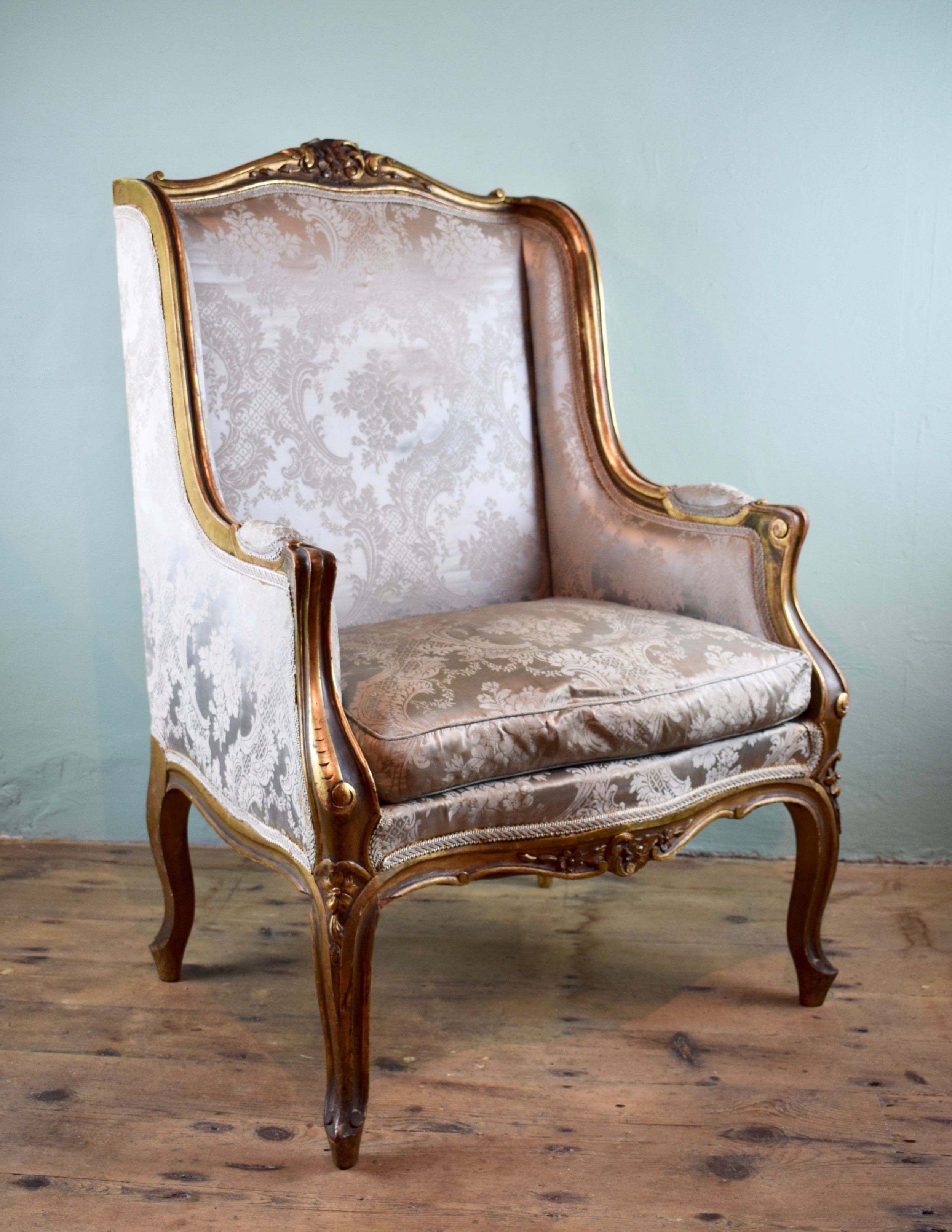 antique french carved giltwood wingback chair in louis xv style