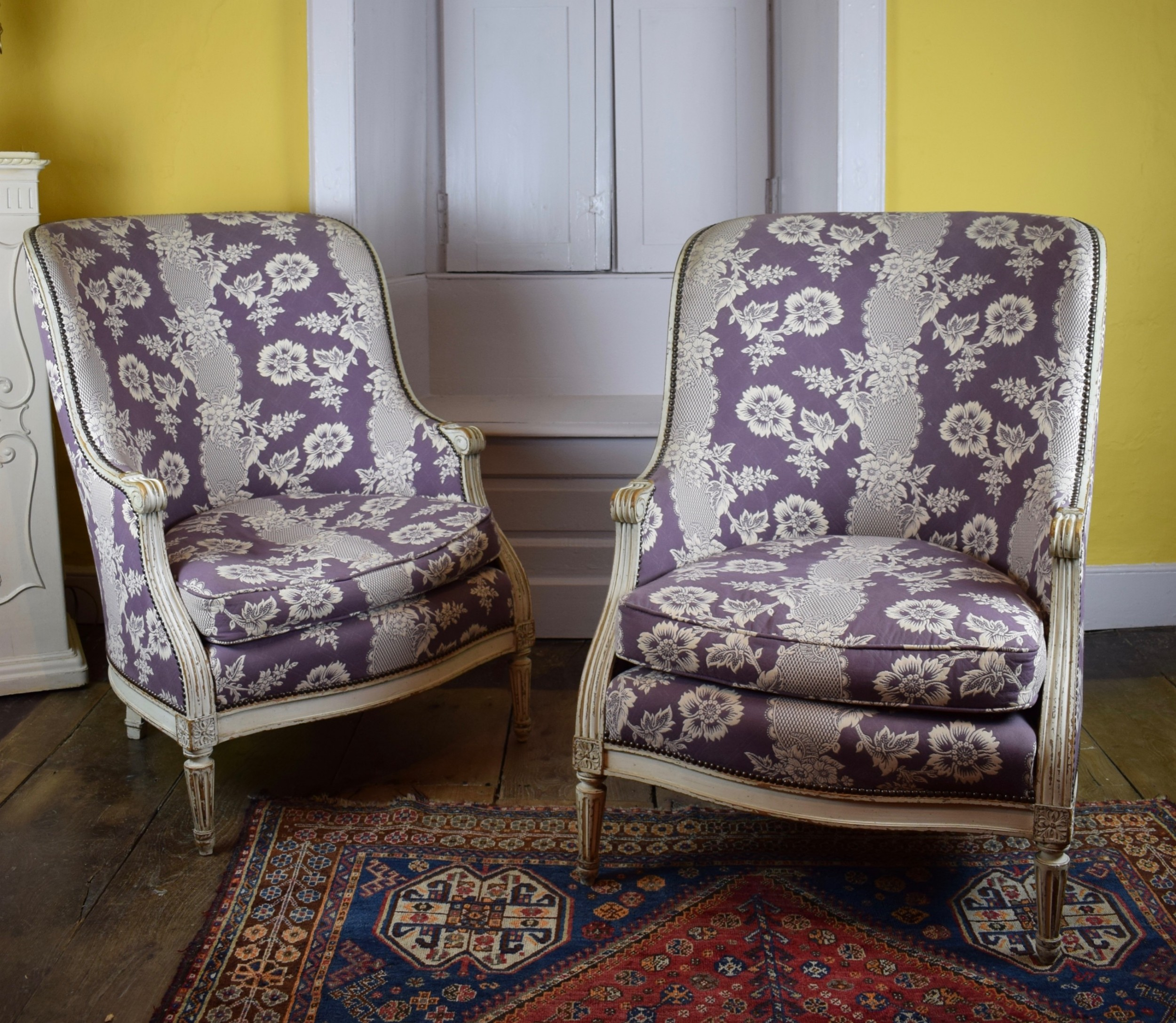 pair of louis xvi style painted tub armchairs with damask upholstery