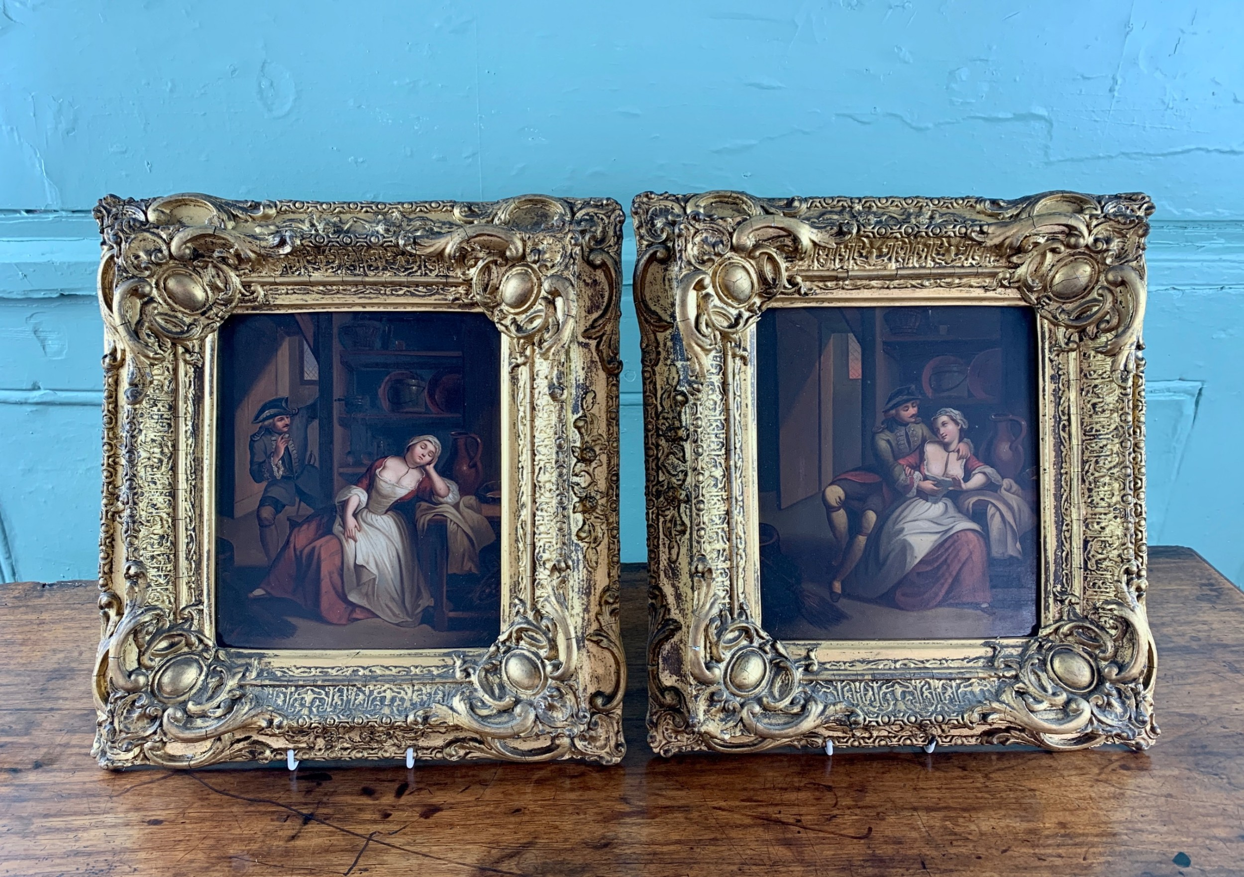 pair of 19th century continental oils of an amorous couple