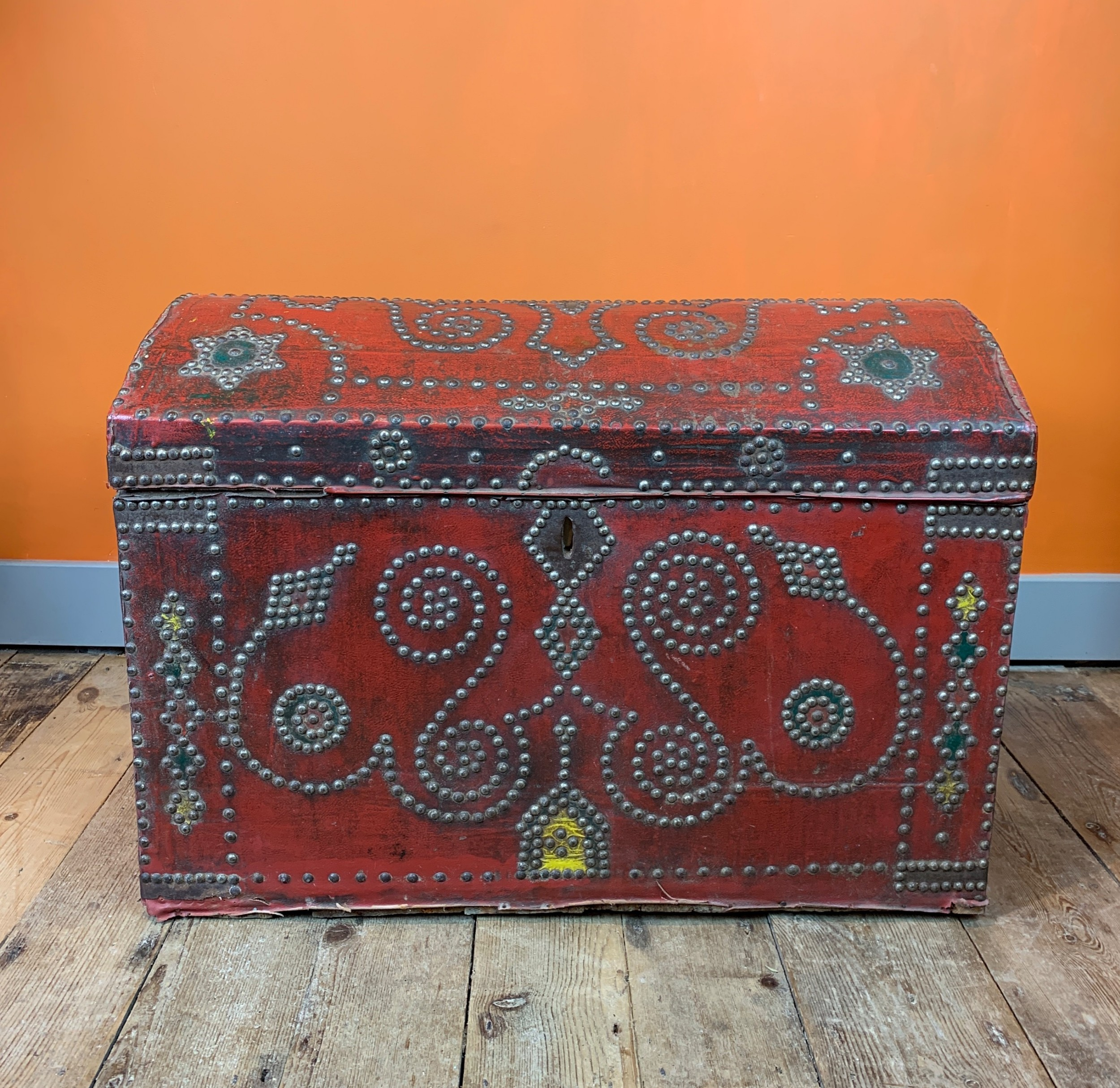 antique cloth covered carriage trunk with nailed studded decoration