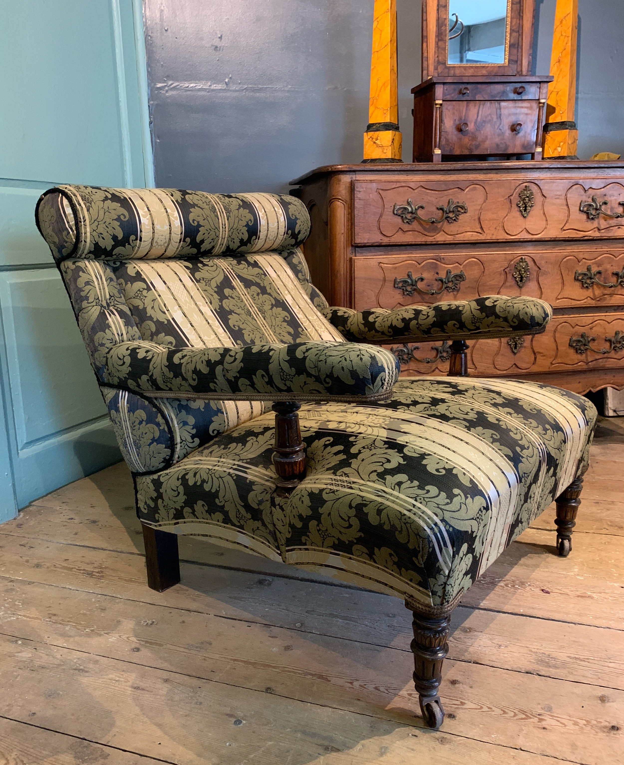 victorian deep seated armchair newly upholstered in damask