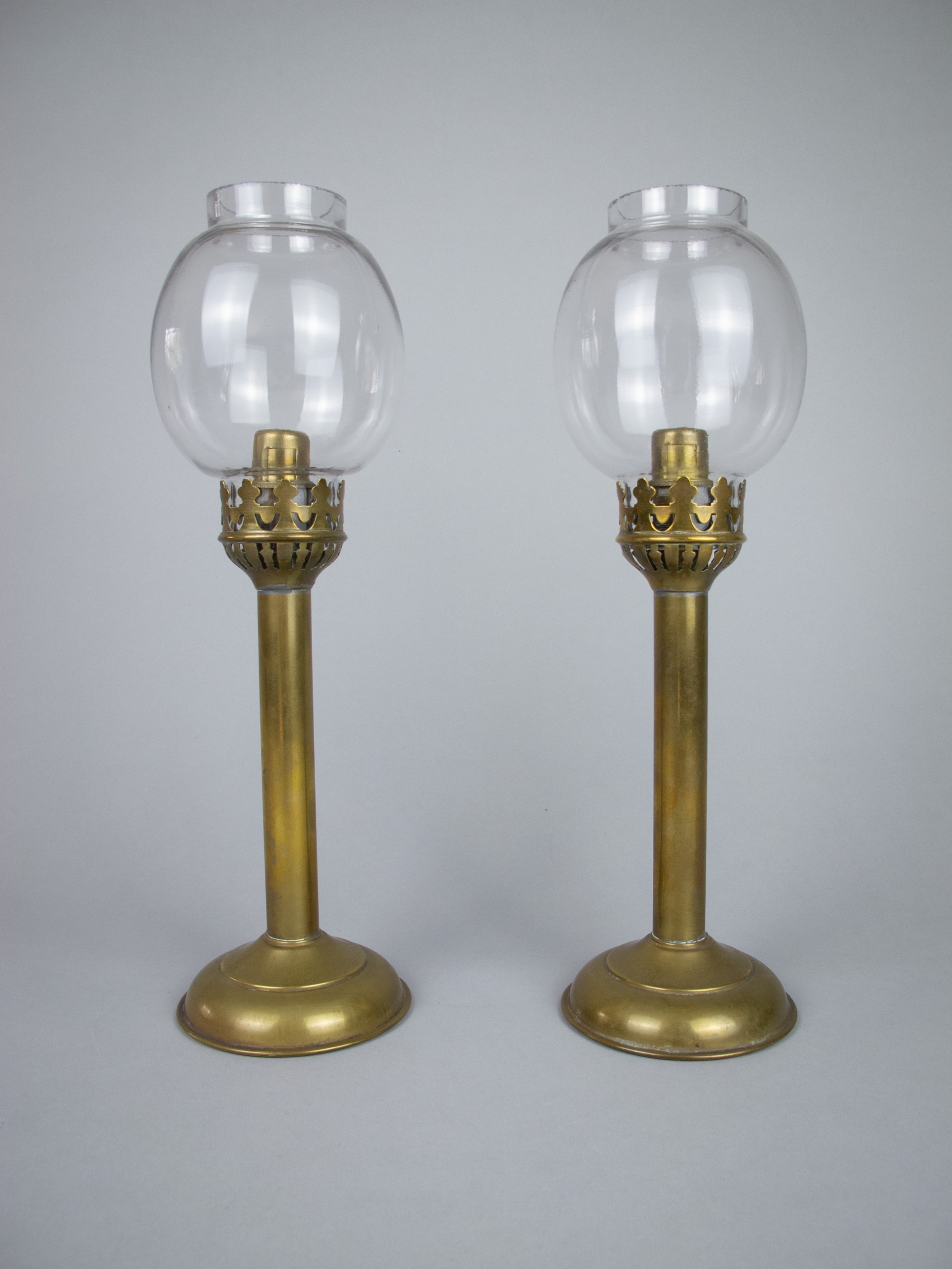 pair of 19th century french brass gothic candlesticks with glass shades