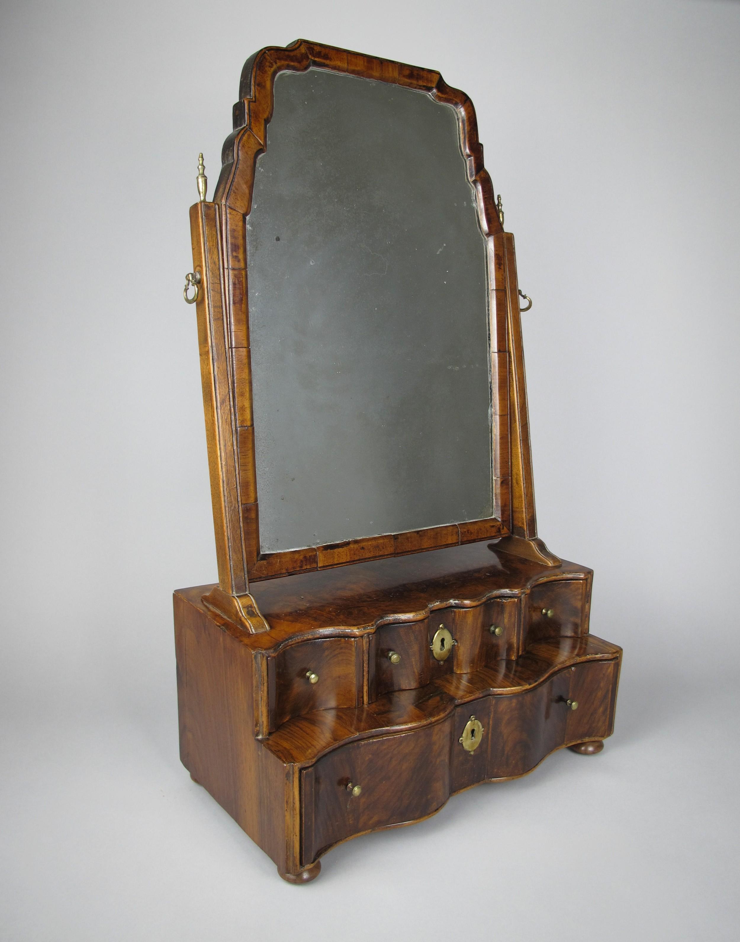 george i walnut swing mirror with four serpentine drawers c1720