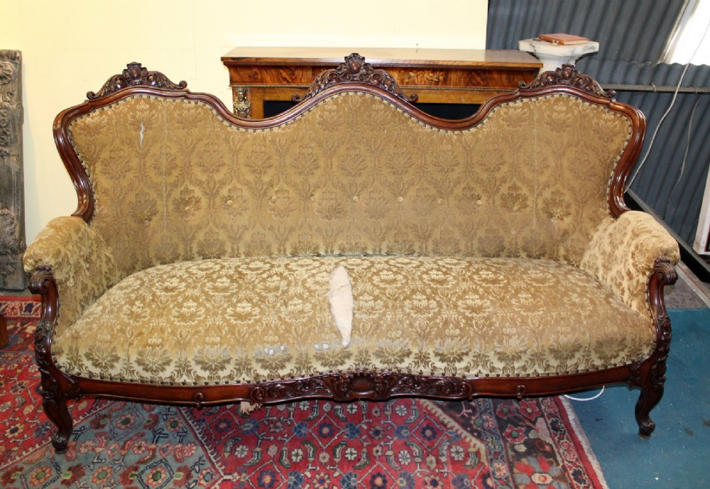 a large ornate victorian carved mahogany chaisesettee