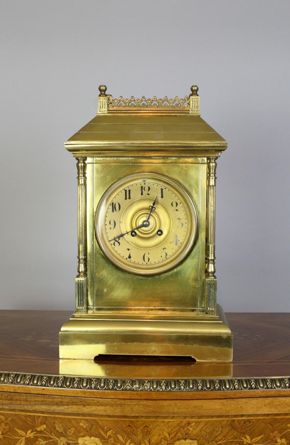a victorian brass mantle clock labelled h bilton