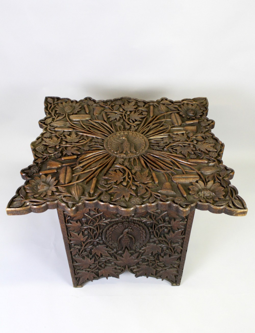 an oriental profusely carved table