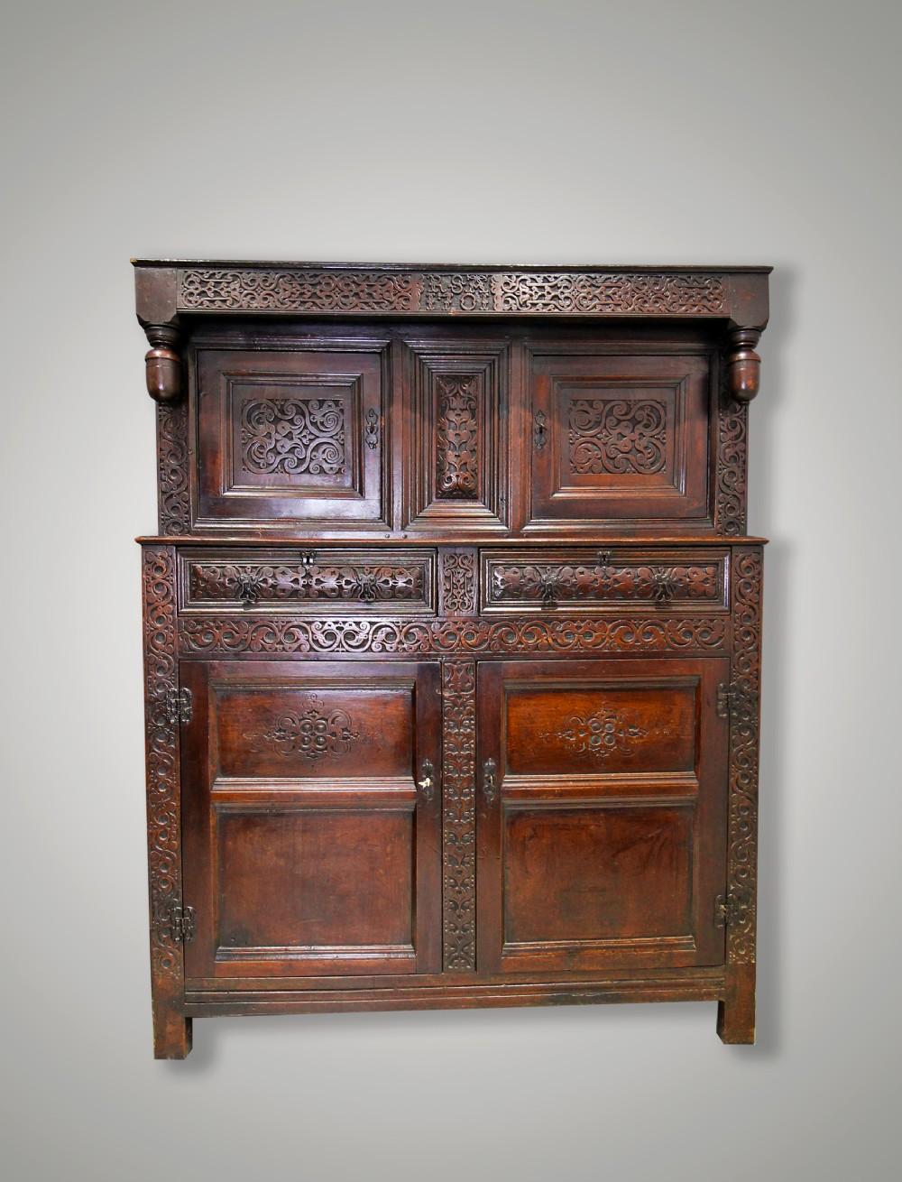 a william iii carved oak press cupboard