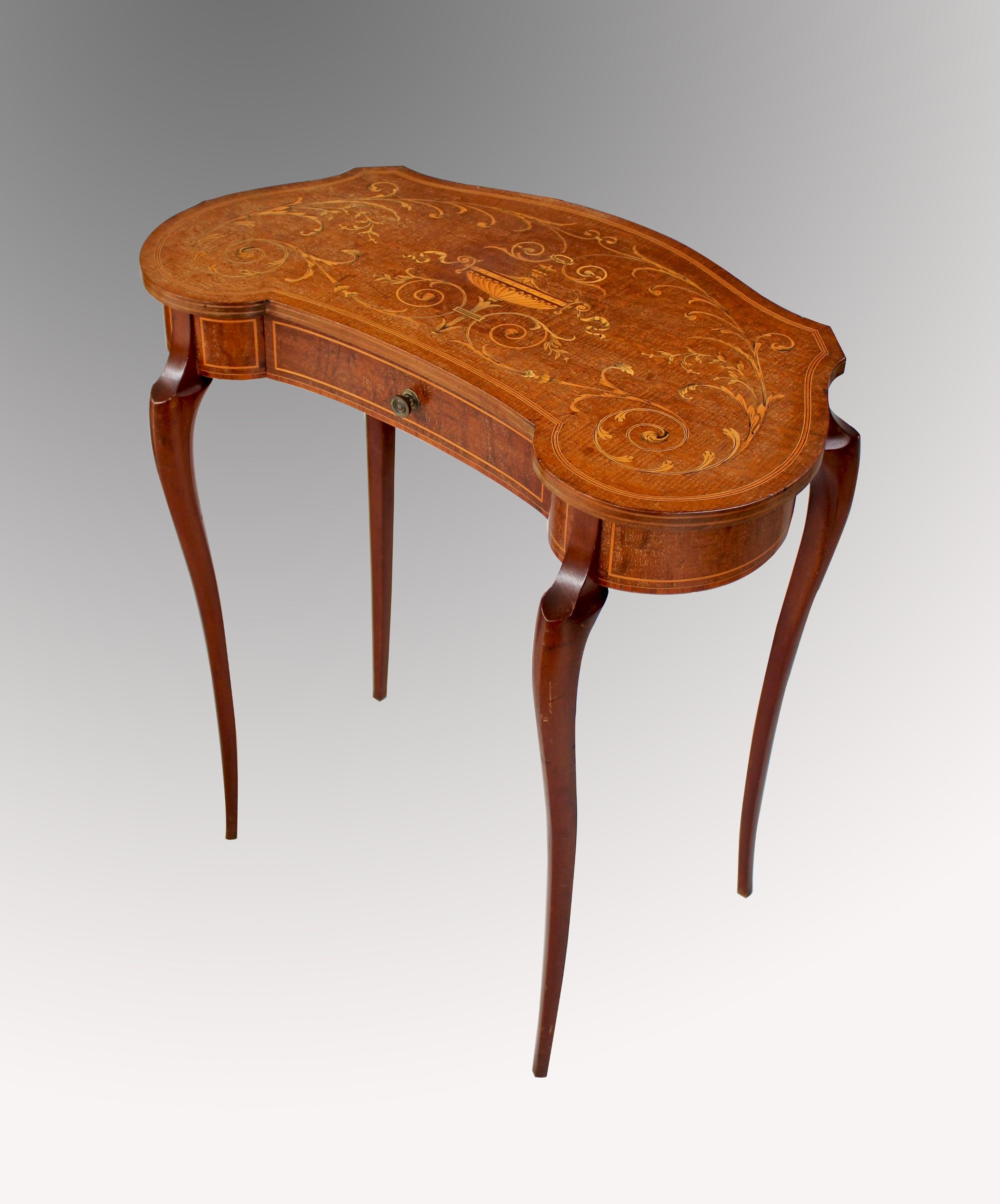 an edwardian mahogany and satinwood marquetry inlaid kidney shaped side table