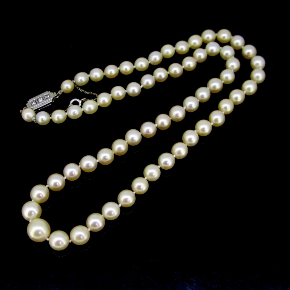 art deco graded cultured pearls diamonds 18kt white gold clasp necklace france circa 1930