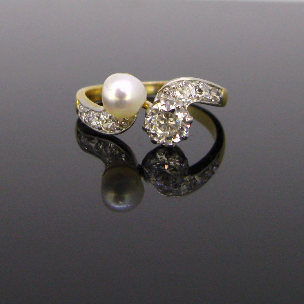edwardian toi et moi crossover natural pearl diamonds ring 18kt gold and platinum circa 1910