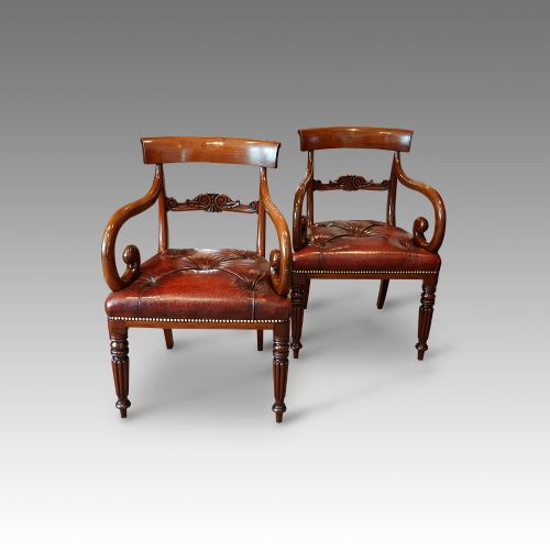pair of william iv mahogany scroll armchairs