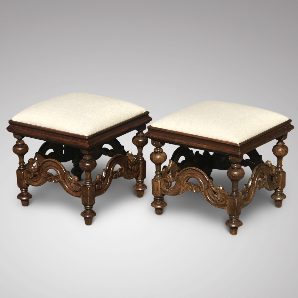 a pair of 19th century walnut stools in charles ii style