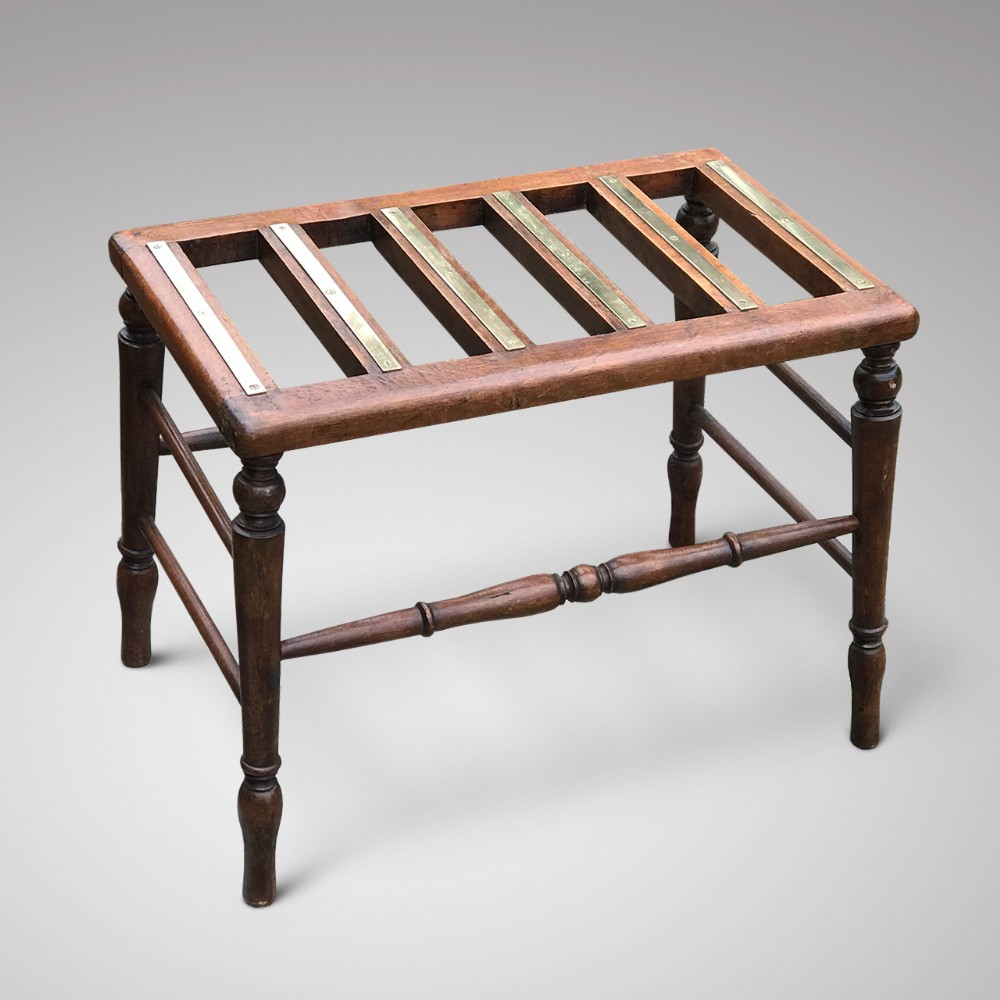 early 20th century mahogany luggage rack with brass strips