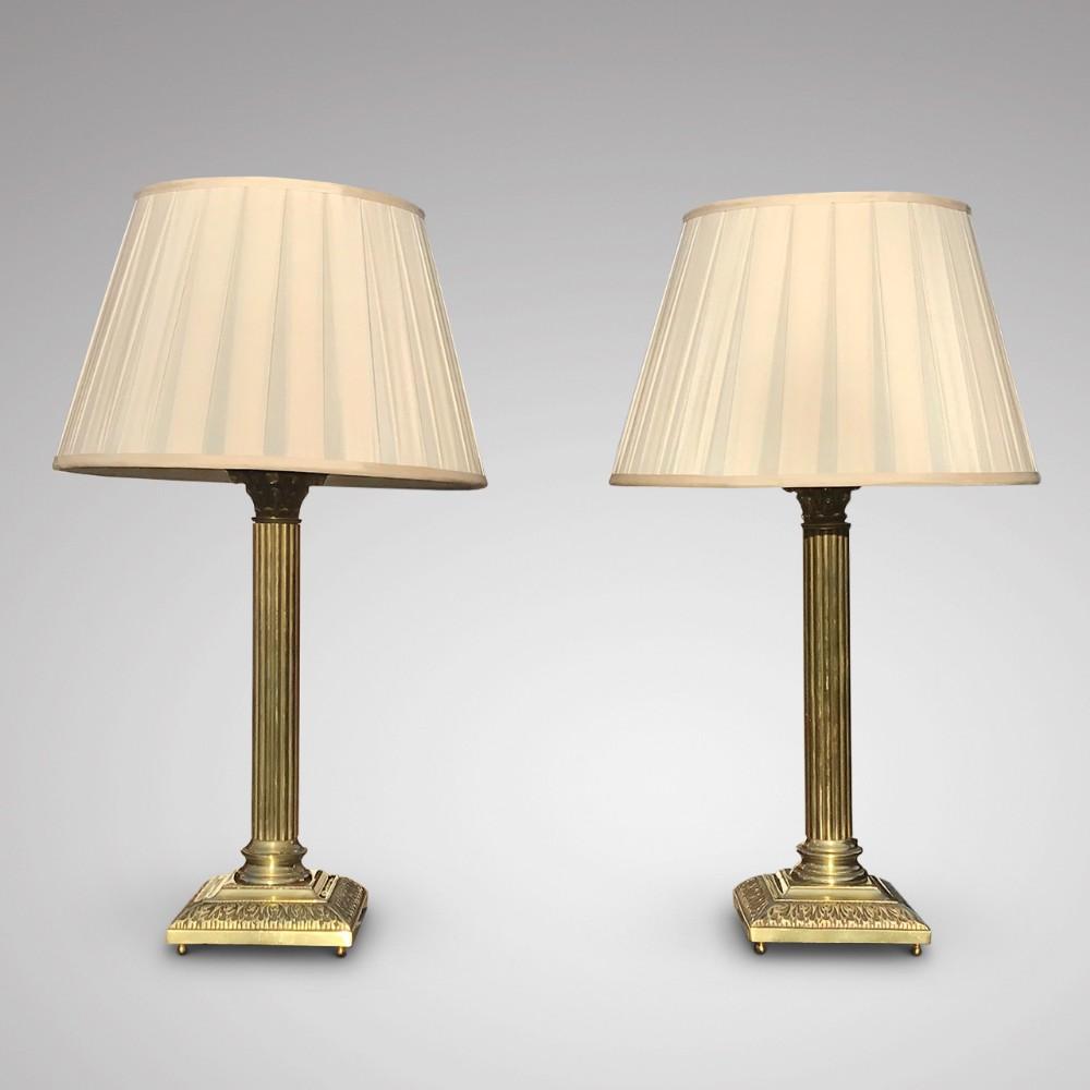 a fine pair of brass corinthian column table lamps