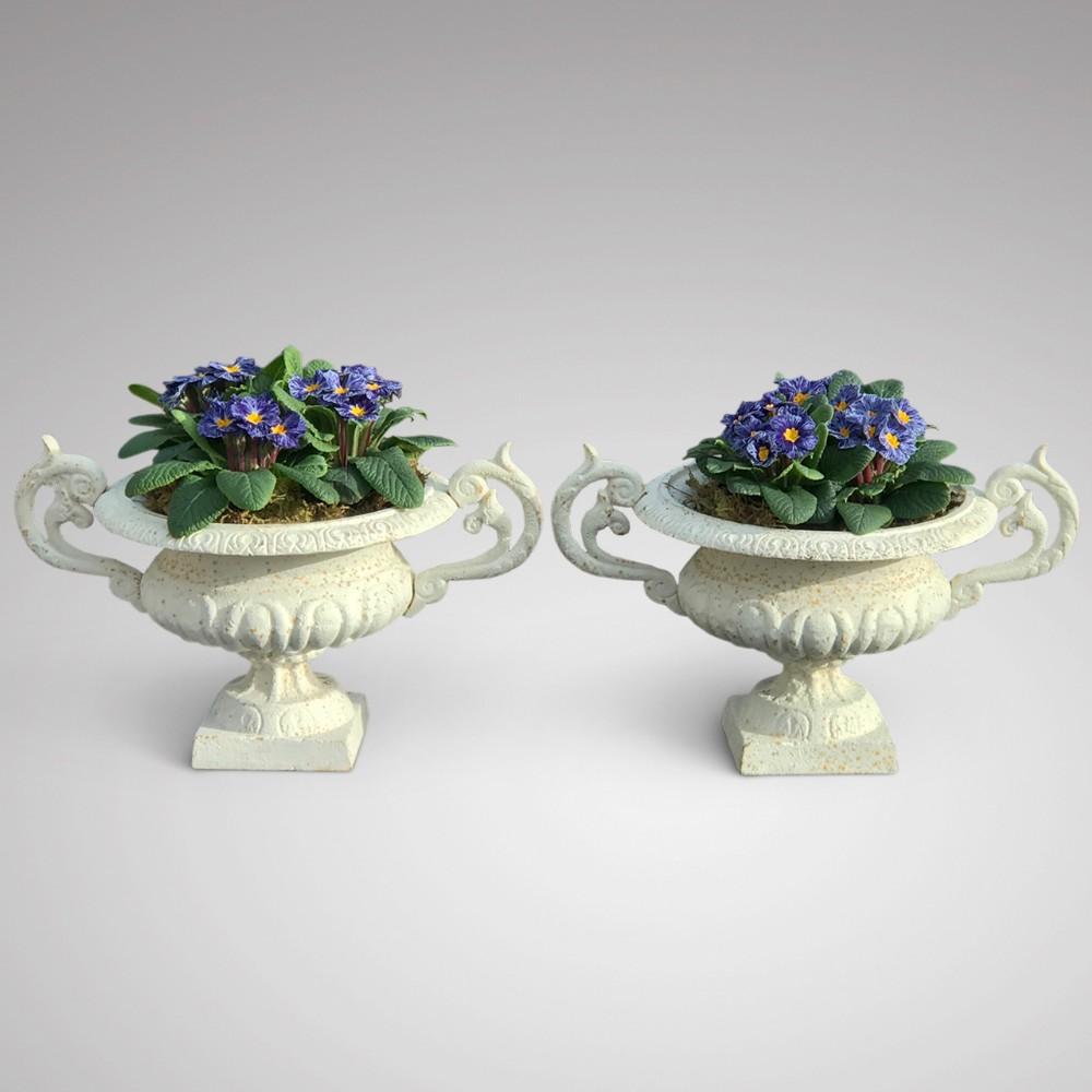 pair of 19th century cast iron garden urns
