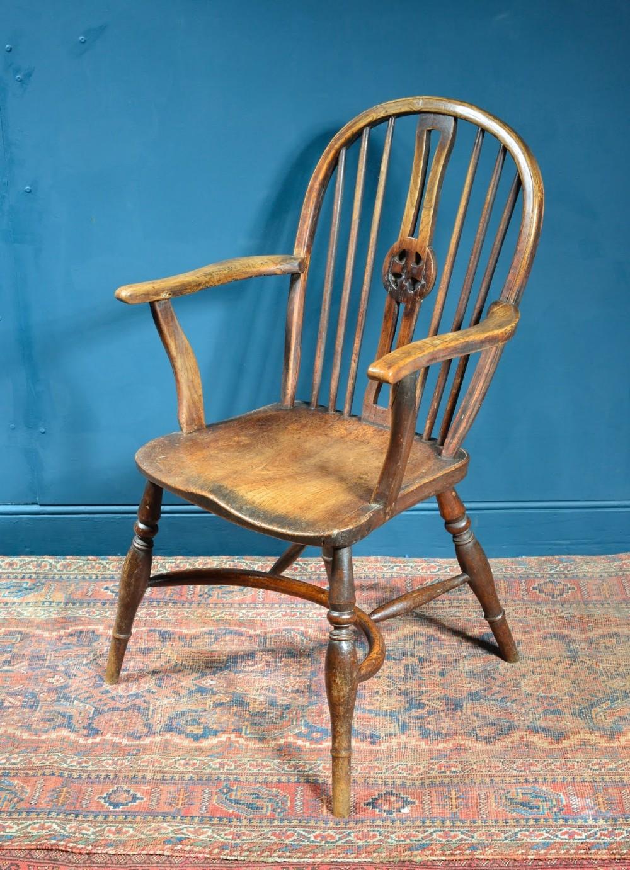 an unusual oak and elm wheel back windsor chair with crinoline stretcher c1800