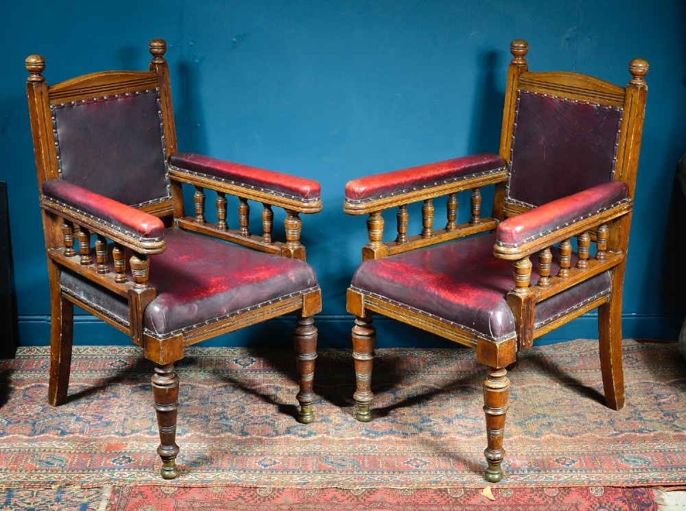 a pair of aesthetic movement oak and leather library chairs in the manner of alfred waterhouse c1880
