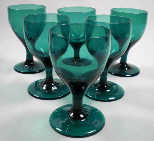 a set of six unusually large tulip shaped bristol green wine glasses english c1790