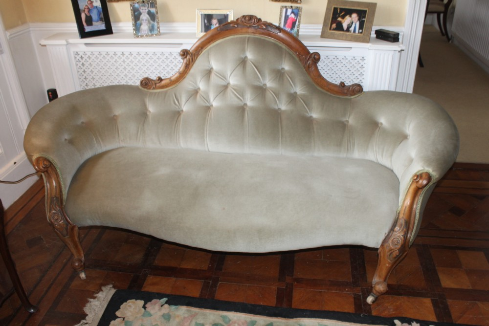 a good quality victorian carved walnut sofa
