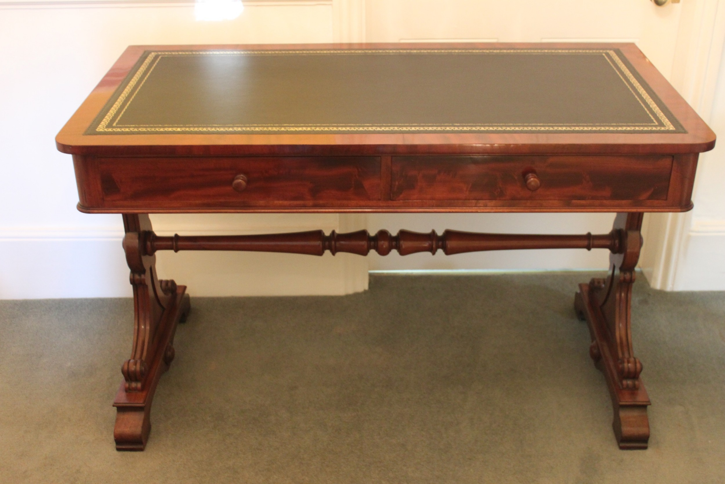 an early 19th century mahogany two drawer writing or library table by gillows of lancaster