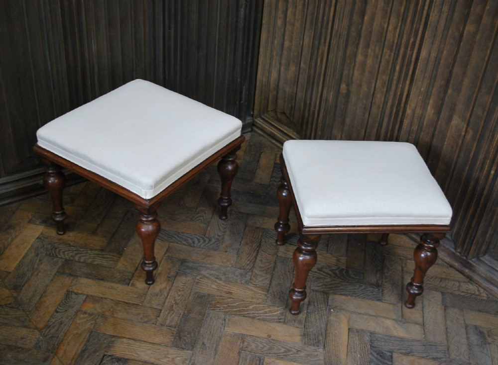 near pair of english upholstered foot stools