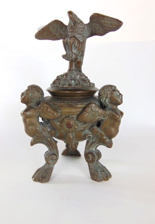 a bronze standish