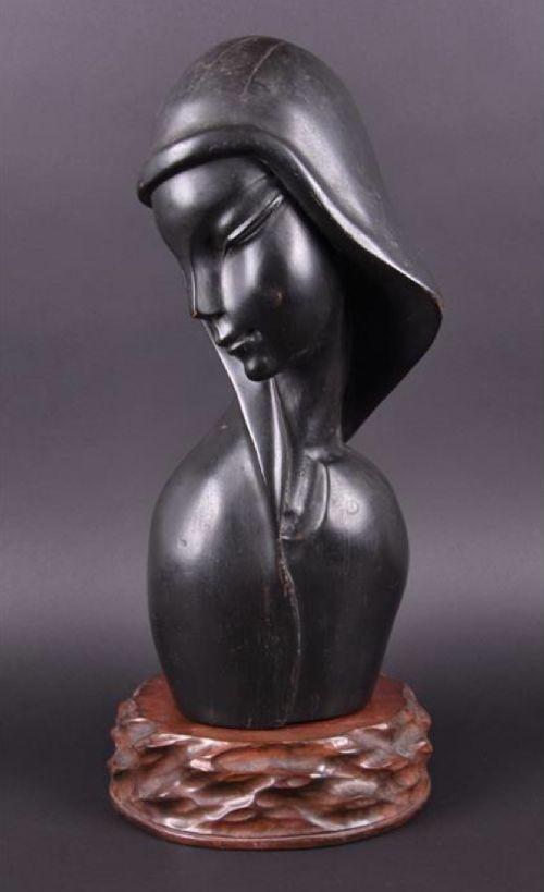 an art deco sculpture of a womans head