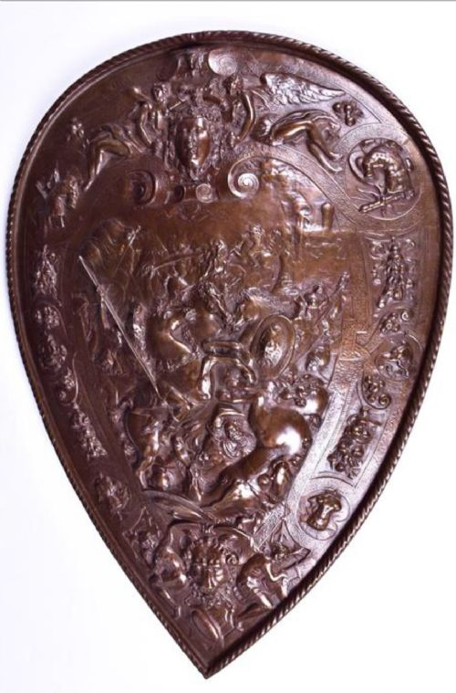 a bronzed cast iron wall hanging shield