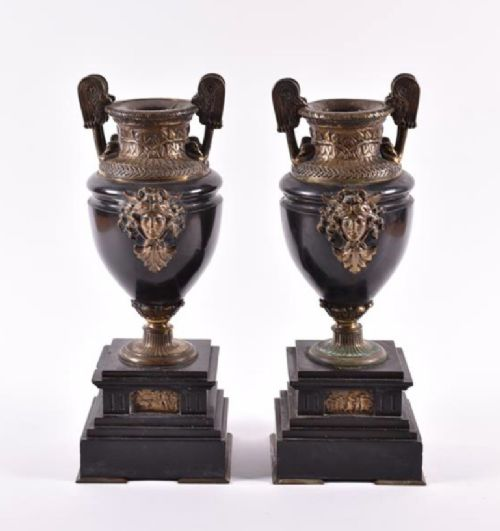 a pair of french empire black marble urns with bronze mounts