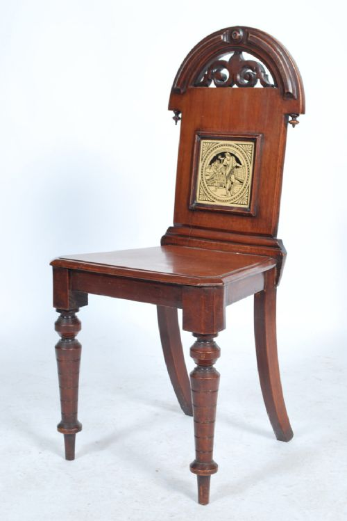 a c19th mahogany hall chair with inset moyr smith tile depicting cymbeline