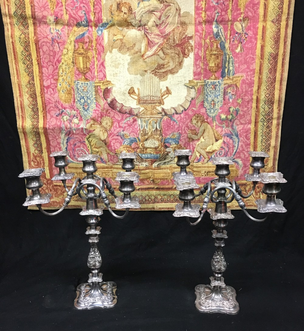 pair of silver plated five light candelabra