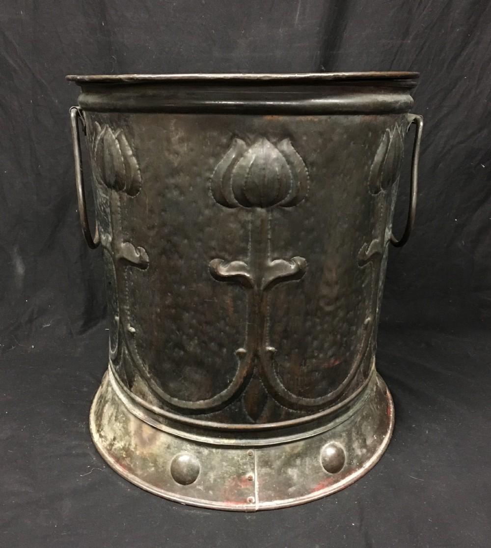 a large arts and crafts log bin coal bin