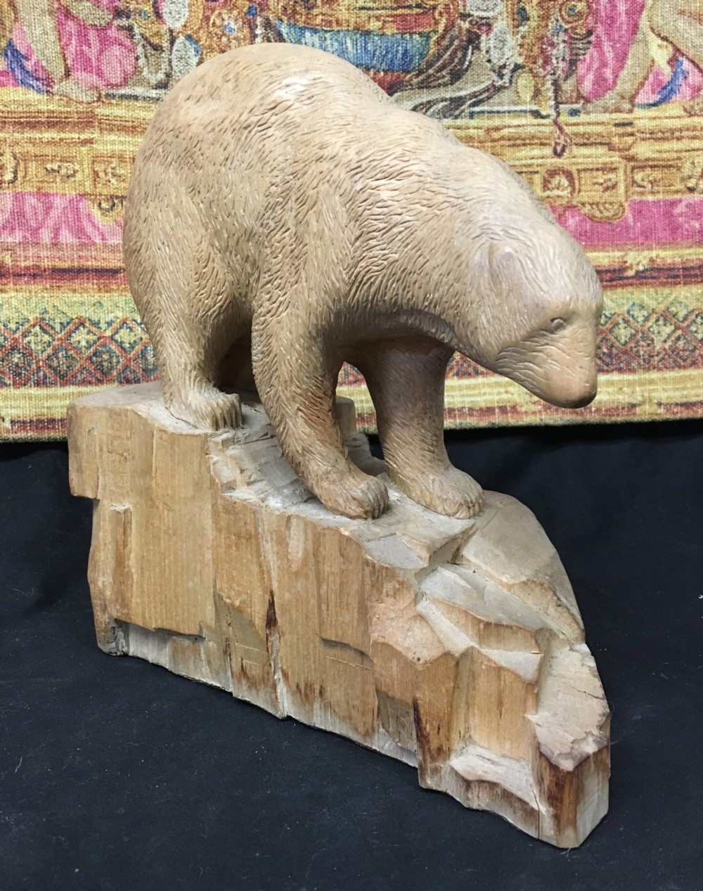 1930s limewood carving of a polar bear on naturalistic base
