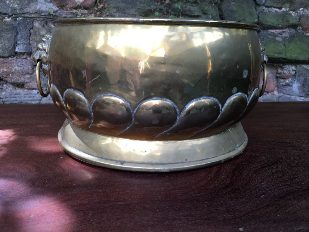 c19th brass planter with lion ring handles