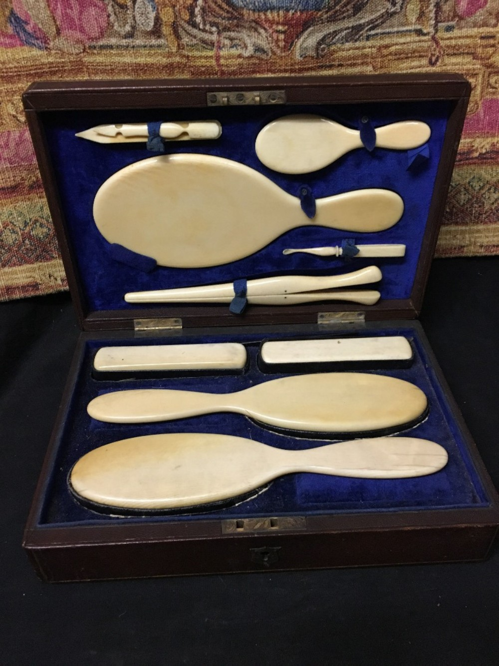 leather travelling case fitted with ivory back accessories