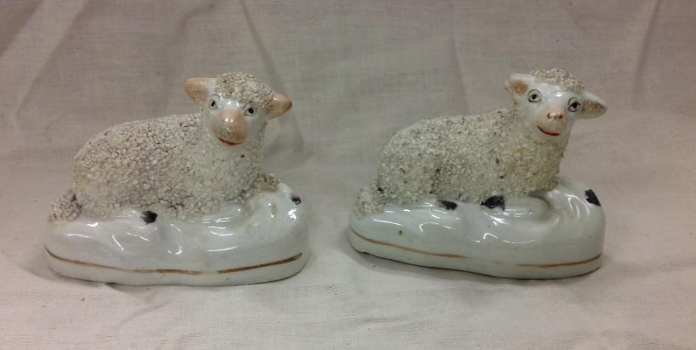 two miniature staffordshire sheep