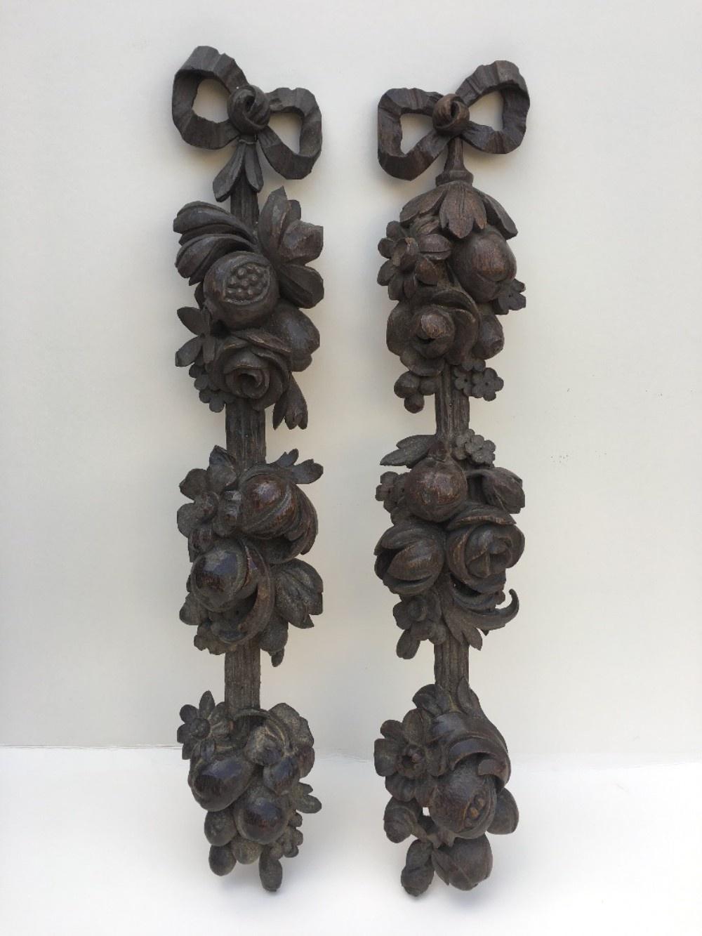pair of carved oak wall hangings