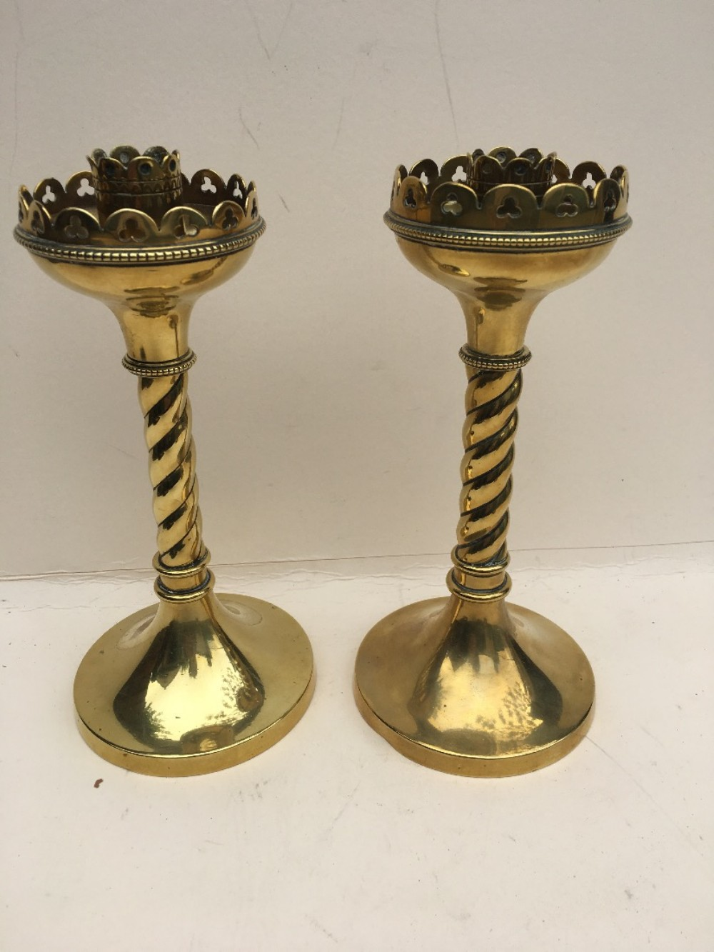 pair of brass gothic candlesticks