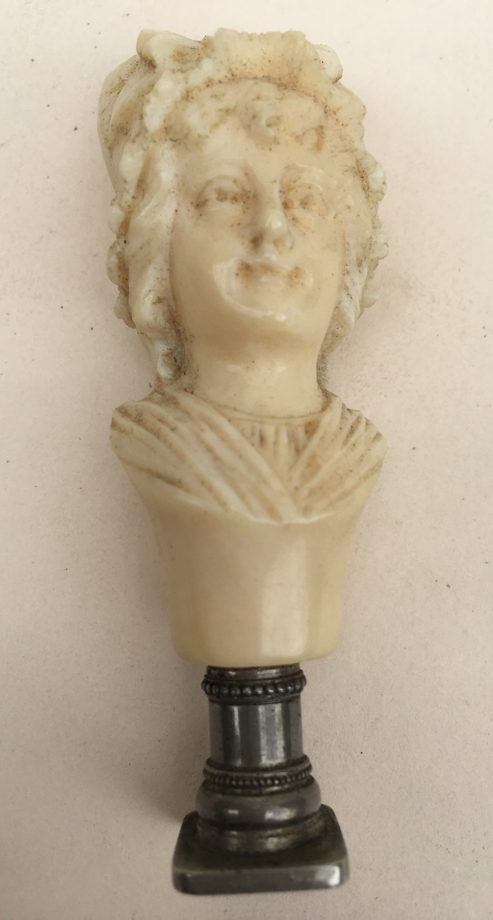 c19th carved ivory dieppe carving of a lady with a seal base