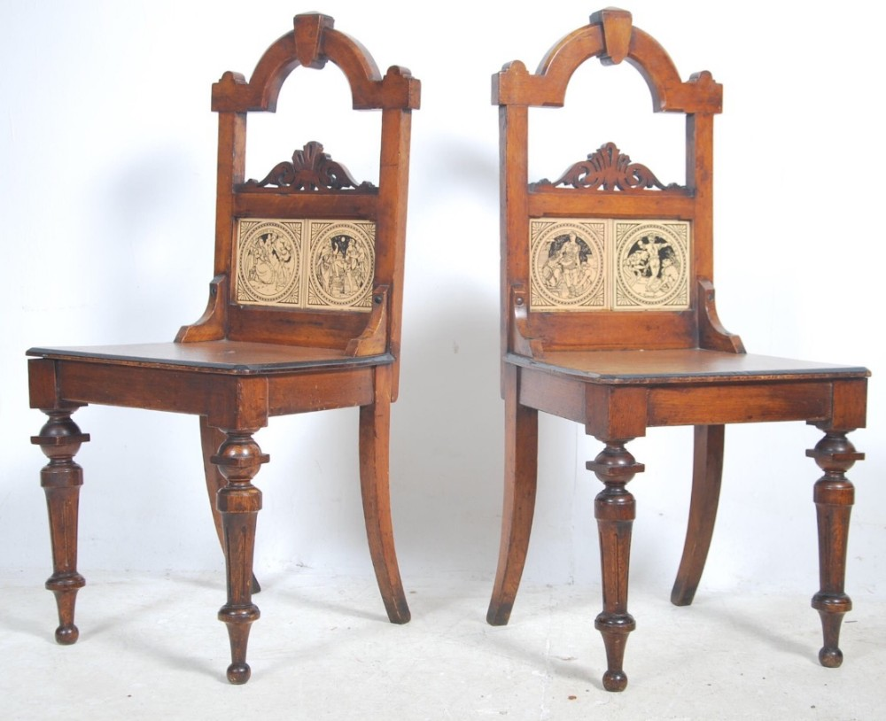 pair of oak hall chairs with with shakespeare tiles inset