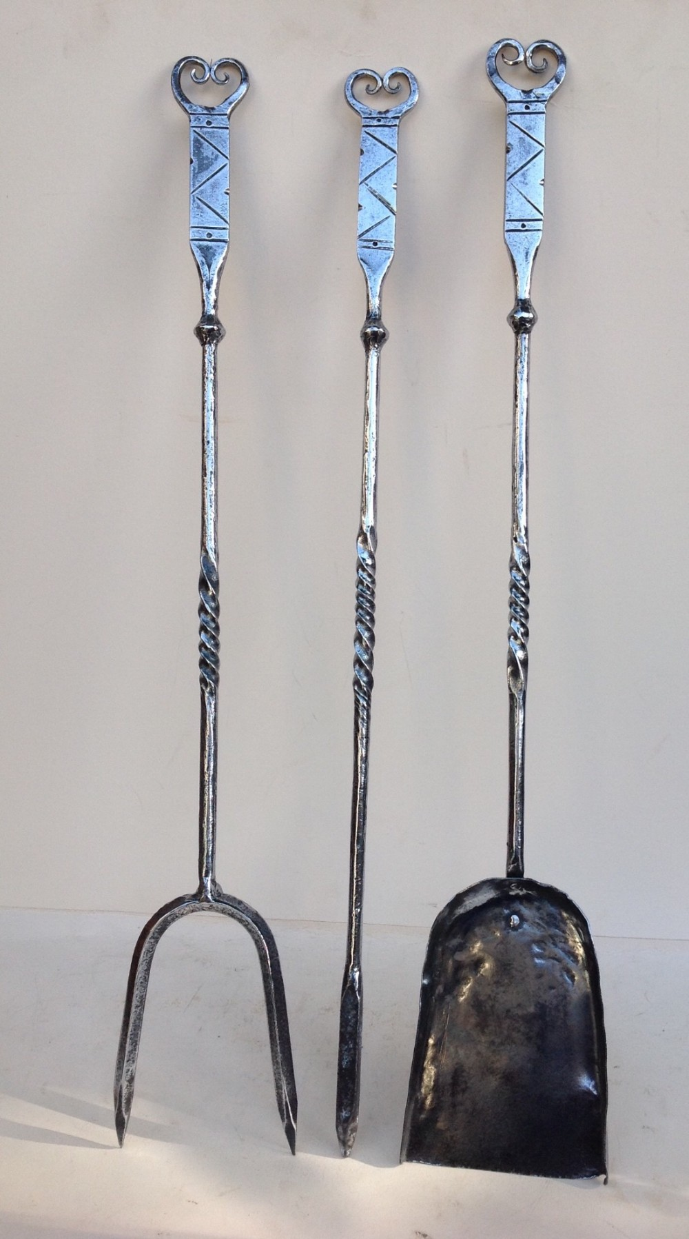 set of three wrought iron fireside tools