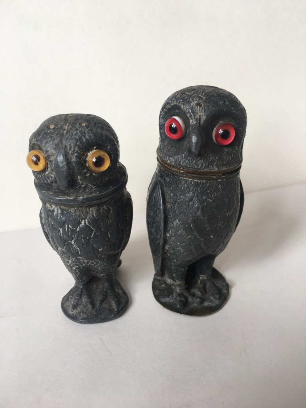two pewter pepper pots modelled as owls