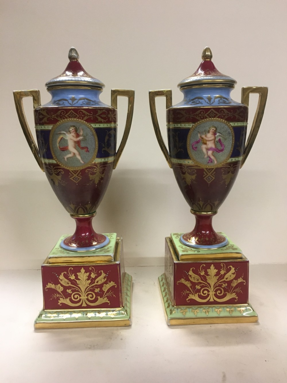 pair of royal vienna urns on stands
