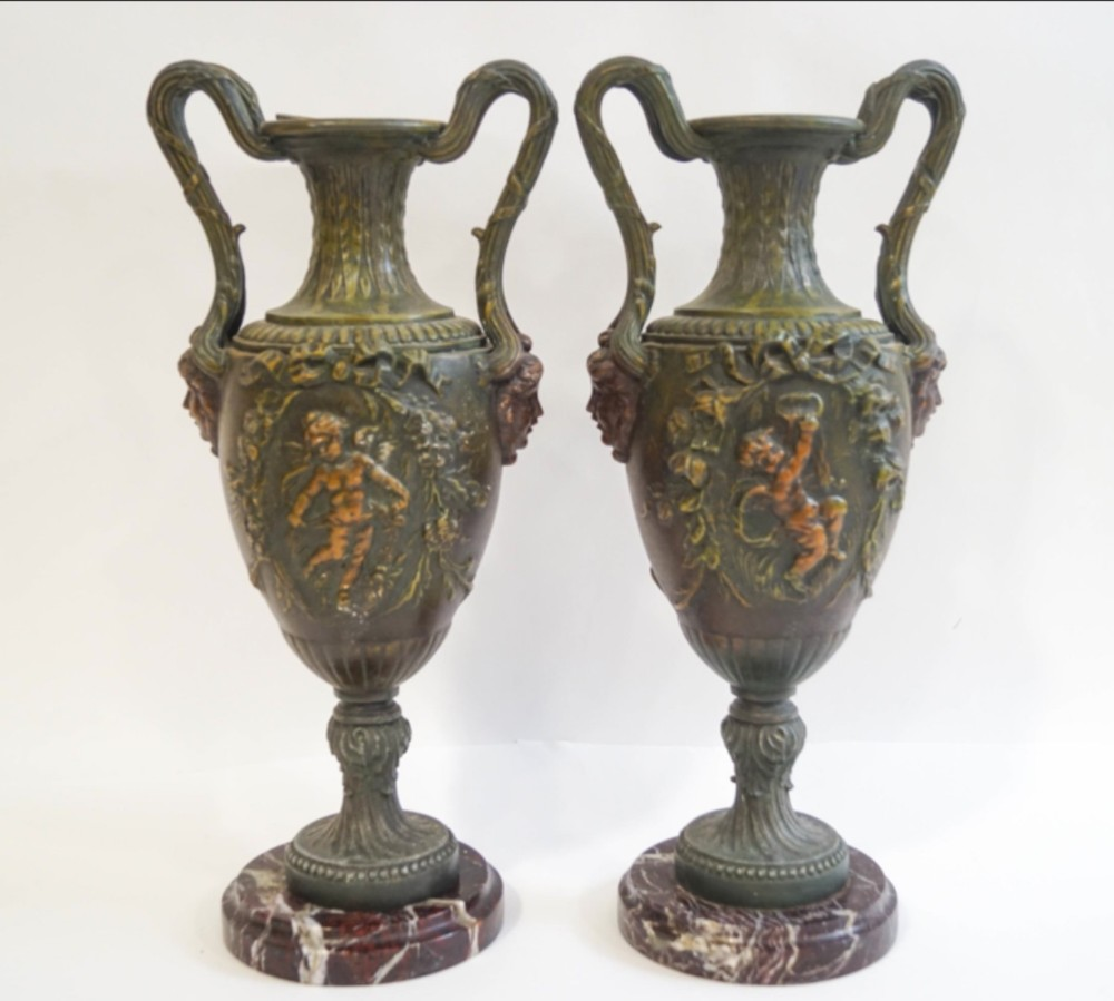 pair of painted spelter urns