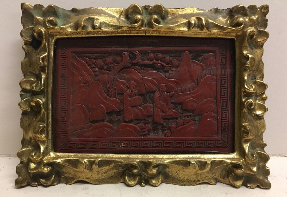 c19th cinnabar lacquered panel in carved gilt wood frame