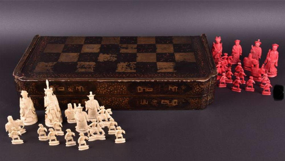 a c19th chinese lacquered chessboard box with ivory chess pieces