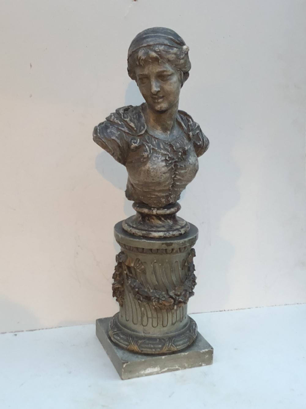 c19th painted plaster bust on carved wooden stand