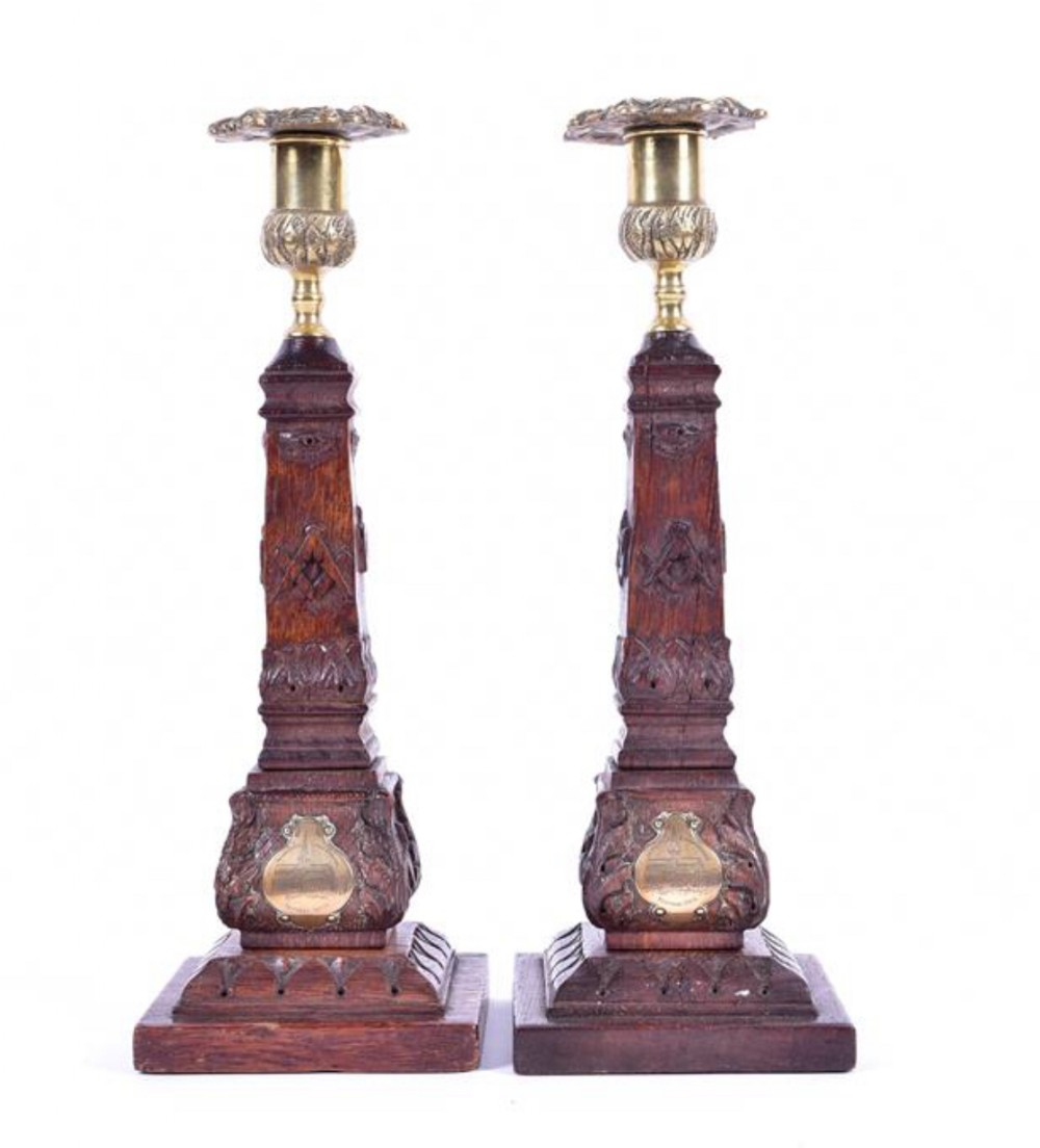a pair of scottish masonic candlesticks